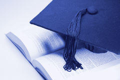 Mortarboard and Book Royalty Free Stock Photo