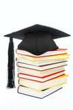 Mortarboard on a book stack stock image