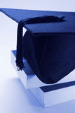 Mortarboard on Books Stock Images