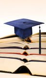 Mortarboard on books Stock Photography