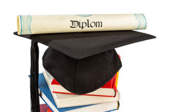 Mortarboard on books stack Royalty Free Stock Images