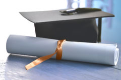 Mortarboard. Diploma and back mortarboard with blue tassel Stock Image