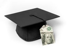 Mortarboard with dollar bill price tag. Mortarboard with 100 dollar bills price tag as a tassle on a white background Royalty Free Stock Photo