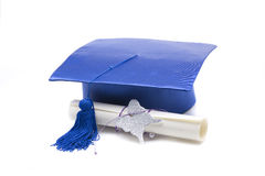Mortarboard e diploma Fotografia de Stock Royalty Free