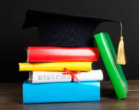A mortarboard and graduation scroll, Royalty Free Stock Photography