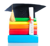 A mortarboard and graduation scroll Royalty Free Stock Photo