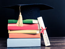 A mortarboard and graduation scroll Royalty Free Stock Photography