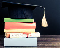 A mortarboard and graduation scroll Stock Photography