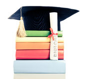 A mortarboard and graduation scroll Royalty Free Stock Image