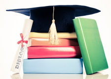 A mortarboard and graduation scroll Stock Photo