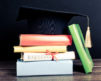 A mortarboard and graduation scroll Stock Photos