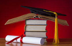 Mortarboard and graduation scroll Stock Photography