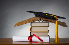 Mortarboard and graduation scroll Royalty Free Stock Photo