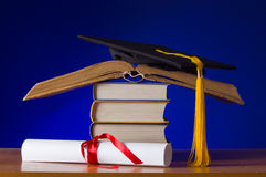 Mortarboard and graduation scroll Royalty Free Stock Image