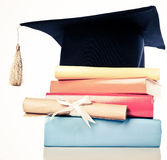 Mortarboard and graduation scroll Stock Image