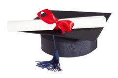 Mortarboard and parchment certificate Stock Images
