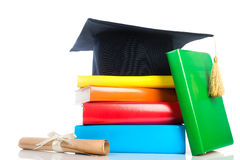 Mortarboard and vintage graduation scroll Royalty Free Stock Photos