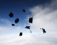 Mortarboards  in the air Royalty Free Stock Photos
