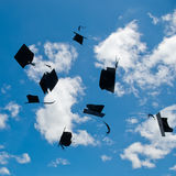 Mortarboards  in the air Royalty Free Stock Image