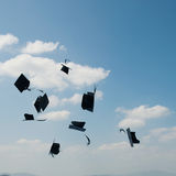Mortarboards  in the air Royalty Free Stock Images