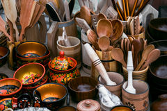 Mortars, Kitchen utensils made of wood, spoons, forks, spatulas. Gastronomy fair Royalty Free Stock Photography