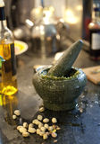 Morter with pesto in kitchen royalty free stock photography