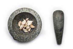 Mortero de piedra en el fondo blanco Imagen de archivo libre de regalías