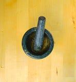 Mortero en el fondo de madera Fotografía de archivo libre de regalías