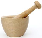 Mortero y maja de mano de madera Fotografía de archivo