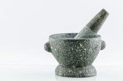 Mortero y maja de piedra Foto de archivo libre de regalías