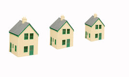 Mortgage. Three houses on a white background mortgage concept Royalty Free Stock Photos