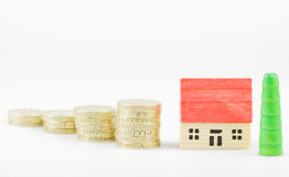 Mortgage. British  pound coins with wooden toy house mortgage concept Stock Images