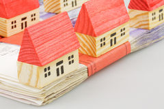 Mortgage. British twenty pound notes with wooden toy house mortgage concept Royalty Free Stock Photography