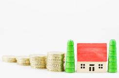 Mortgage. British  pound coins with wooden toy house mortgage concept Stock Photography