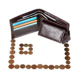 Mortgage. Metaphor of mortgage - brown wallet with cards and coins arranged on house isolated on white background Royalty Free Stock Image