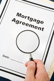 Mortgage Agreement. And magnifier close up Stock Photos