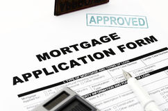 Mortgage Application Form. Shot in the home loan application form has been approved stamp Stock Image