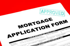 Mortgage. Application form on the approved stamp Stock Images