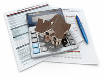 Mortgage application form with a calculator and house. Stock Photography