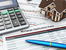 Mortgage application form with a calculator and house. Royalty Free Stock Photos