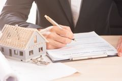 Mortgage Application Form. Hand Filling The Document Closeup Royalty Free Stock Photos