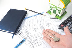 Mortgage application form, top view, house model, notebook, calc Stock Photo