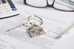 Mortgage application. Mortgage loan agreement application with house shaped keyring royalty free stock photography
