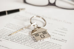 Mortgage application. Mortgage loan agreement application with house shaped keyring stock image