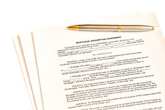 Mortgage assumption agreement with a pen Royalty Free Stock Photo