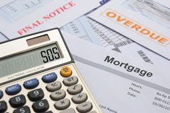 Mortgage and bills to pay. SOS Stock Image