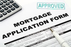 Mortgage. Calculator Mortgage application form and pen Stock Photo