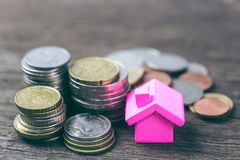 Mortgage concept. House and coins for property ladder, mortgage. stock photo
