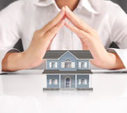 Mortgage concept by house from hand Stock Photo