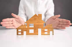 Mortgage concept by house from hand Stock Image